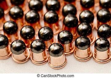 Gun bullets over white background