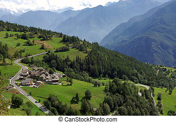 Aosta Valley - group of houses along a road in a slope of...