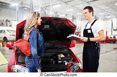 Car mechanic and woman client. - Car mechanic in uniform....