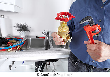 Plumber with a wrench.