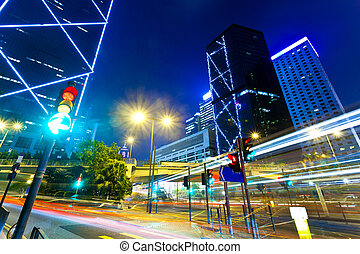 Light trails with modern buildings background