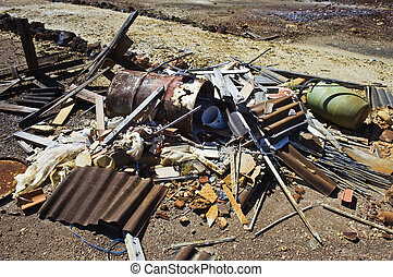 Pile of debris neglectfully abandoned in a field