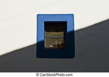 Small window painted with a blue border