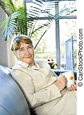 Elderly woman relaxing