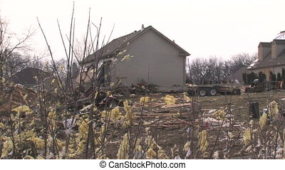 Destroyed Home 1 - Panning across the path of destruction of...