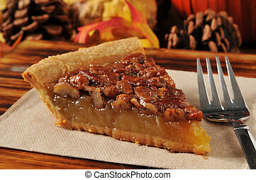 Slice of pecan pie - A slice of pecan pie with a festive...