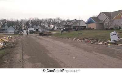 Destroyed Home 2 - Panning across the path of destruction of...