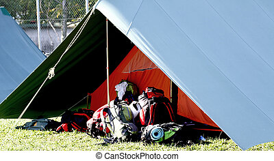 big tent of boy scout camp and the rucksack put out in the...