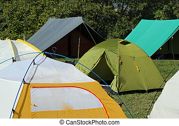 encampment of tents in a soccer field to collect people -...
