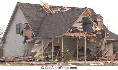 Destroyed Home 3 - Zooming out from a house that has been...
