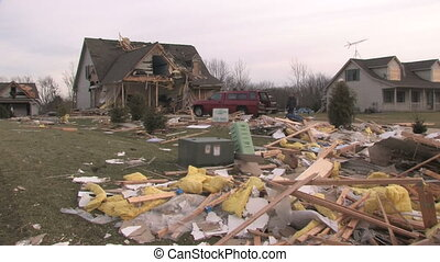 Destroyed Home 4 - Wide shot of a house that has been...