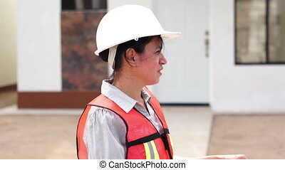Hispanic Female Foreman Smiling - Close up of a middle aged,...