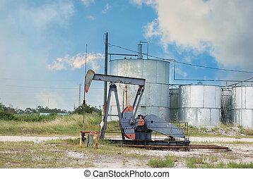 Oil Derrick pumping oil near Houston, Texas USA