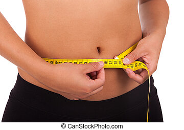 Young african american woman measuring her belly