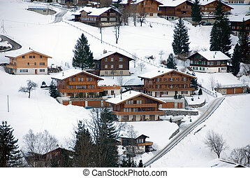 Chalets in the Snow - Chalets in the Swiss town of...