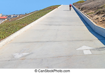 Pedestrian footpath and bike path going up. White painted...