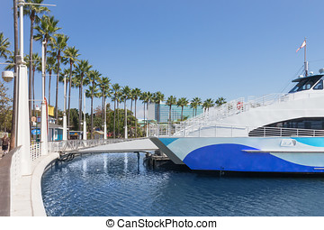 Tour boat docked in Long Beach California city harbor -...