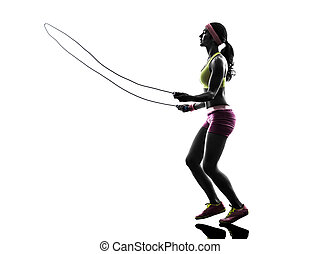 woman exercising fitness jumping rope silhouette - one...