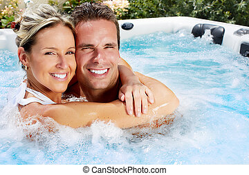 Happy couple in jacuzzi. - Happy couple relaxing in hot tub....