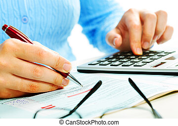 Hands with calculator - Hands of accountant with calculator...