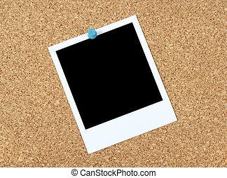 Blank photo on a corkboard