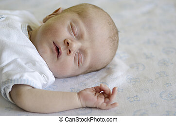 Cute baby sleeping on its back - Face of a ute baby sleeping...