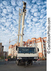mobile crane - Mobile crane truck and blue sky at...