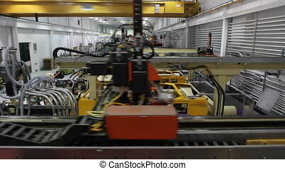 Factory Robotics Crane Shot - A crane shot of a robotics...