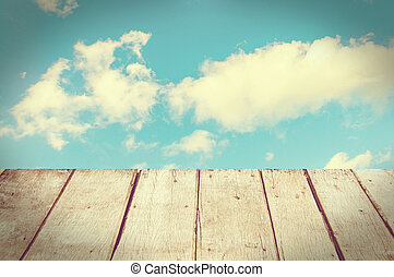 Background of beautiful blue sky and wooden deck