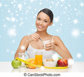 woman with healthy breakfast and measuring tape - food,...