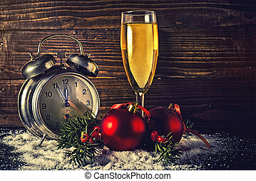 Christmas balls and vintage clock with glass of champagne -...