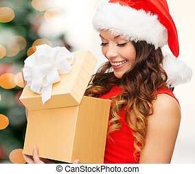smiling woman in santa helper hat with gift box
