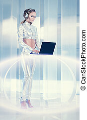 future technology - Beautiful young woman in silver latex...