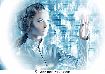 touchscreen - Beautiful young woman in silver latex costume...