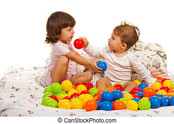 Baby boy and toddler girl with balls - Baby boy and toddler...