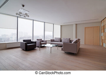Modern office building interior with large sofa