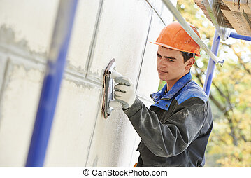 facade builder plasterer at work - builder worker facade...