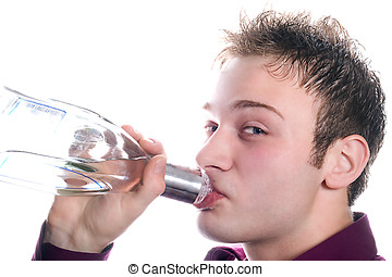 The young man drinks vodka from a bottle. Isolated