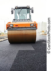 compactor roller at asphalting work - Heavy cibration roller...