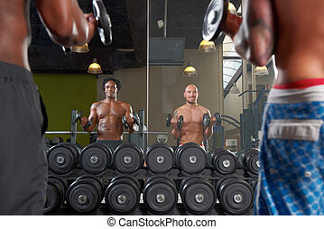Mirror reflection of two men exercising in gym - Mirror...