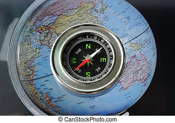Compass on world map background