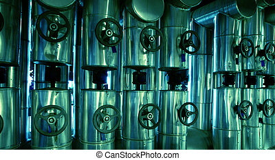 different size and shaped pipes and valves at a power plant...