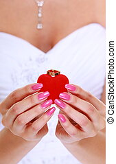 Female hands with engagement or wedding ring, isolated