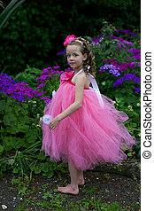 Ballerina - Little ballerina playing in a garden