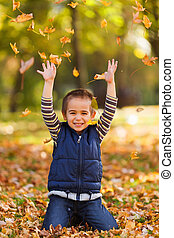 Excited boy playing - Little excited boy playing with leaves...