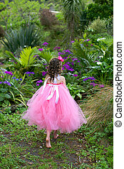 Lovely ballerina. - Little ballerina playing in a garden.
