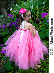 Lovely ballerina - Little ballerina playing in a garden