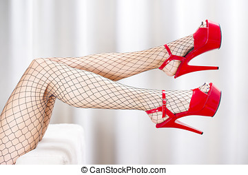 Sexy legs in fishnet stockings and red platform shoes - Legs...