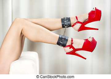 Sexy legs with ankle cuffs and red platform shoes - Female...