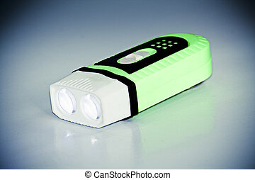 led pocket torch - A flash light isolated against a white...